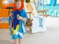 Toddler in Towel at Goldfish