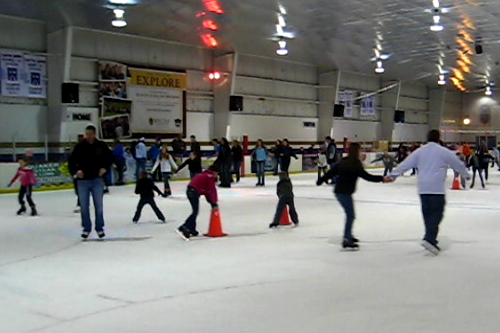 Kids Using Construction Cones to Learn to Ice Skate